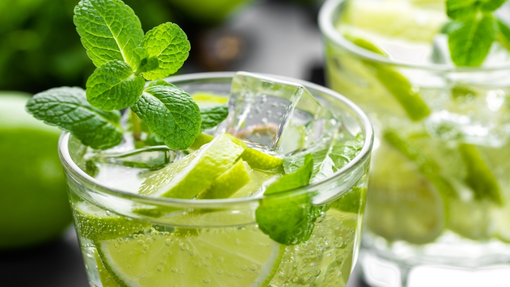 Mint, lime and ice cubes in a glass