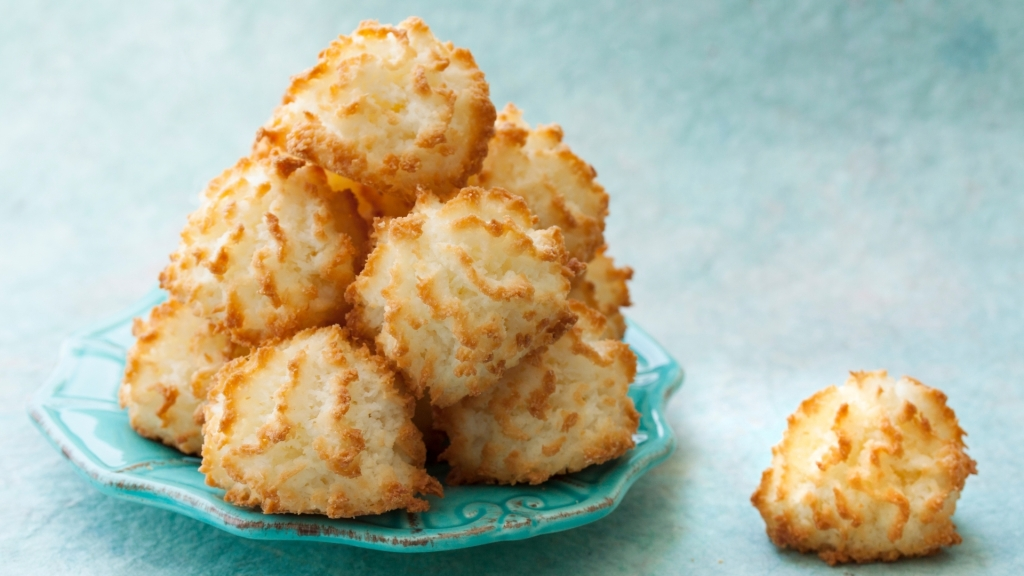 Coconut macaroons stacked on a plate
